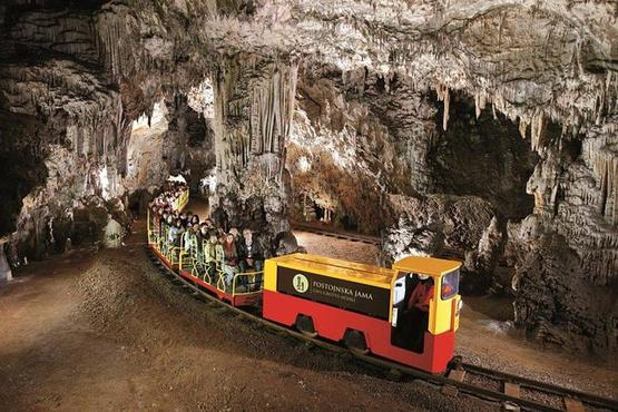 Postojna Cave and Predjama Castle from Sistiana